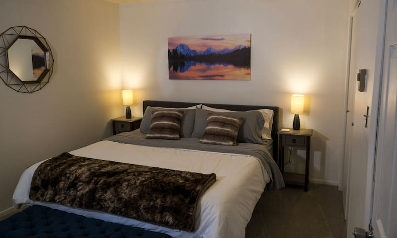 The bedroom features a luxurious, 12-inch, memory foam, king bed.