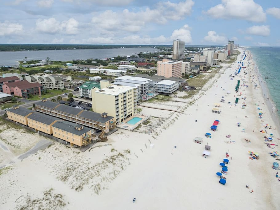 Steps from the beach, this family-friendly 2BR condo sleeps 7