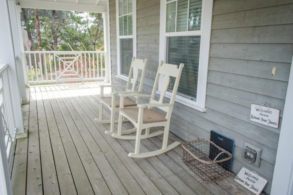 Wrap around covered front porch with seating