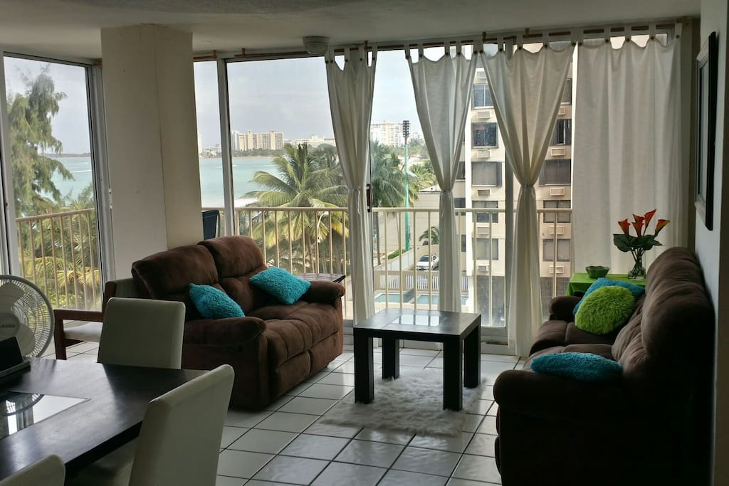 All glass sliding door  windows, in living room space!!!! Very Breeze, fresh, with Amazing ocean view!!  Condo is right on the Sand, on Isla Verde Beach!!