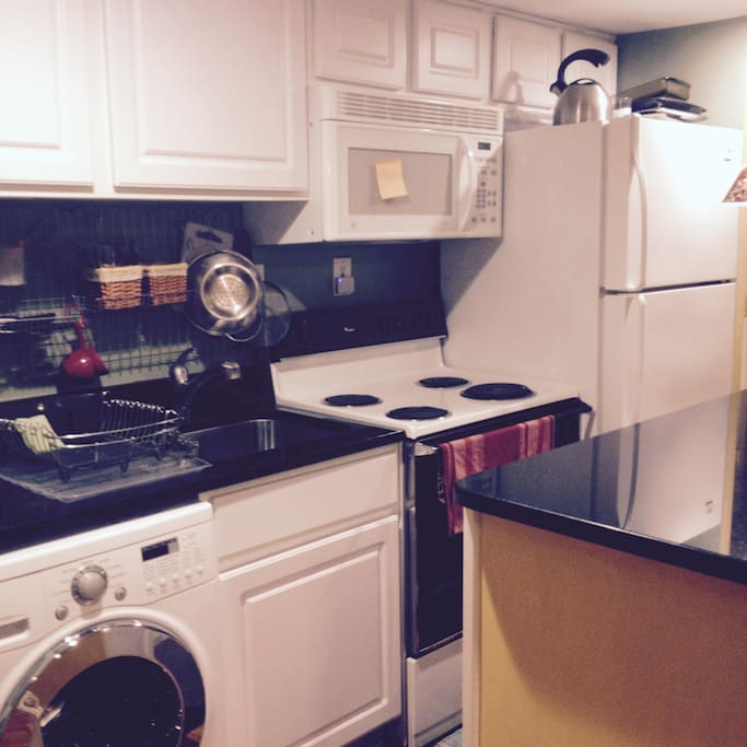 Full kitchen with refrigerator, stove/oven, microwave.