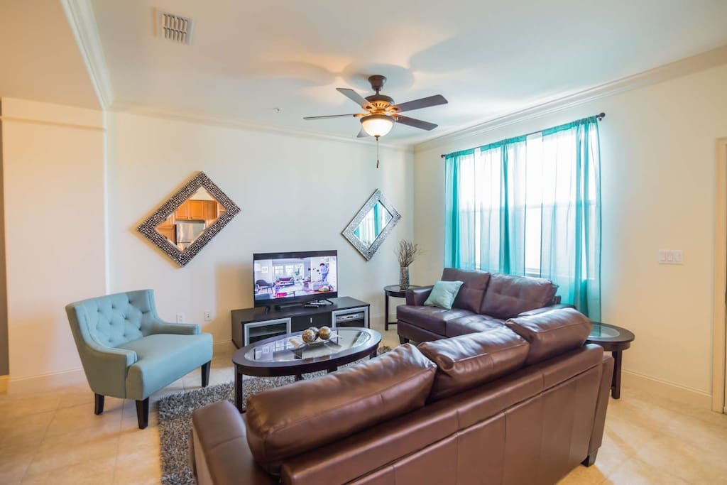 Living Area w/Leather Furniture & Flat Screen TV