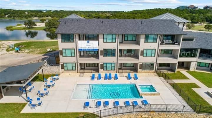 Incredible BRAND NEW lake front poolside condo!