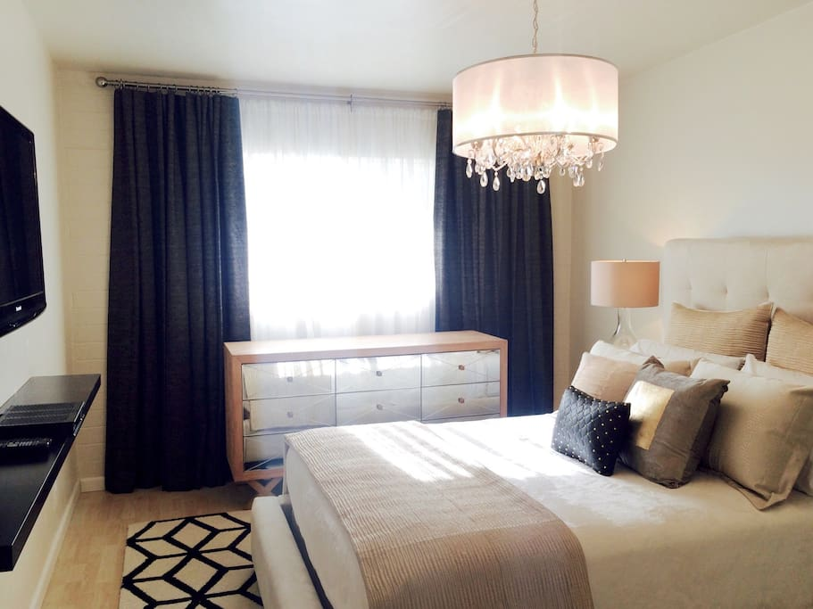 The black-out draperies and privacy sheers provide deep sleep and maximum light control.  (Photo faces west).