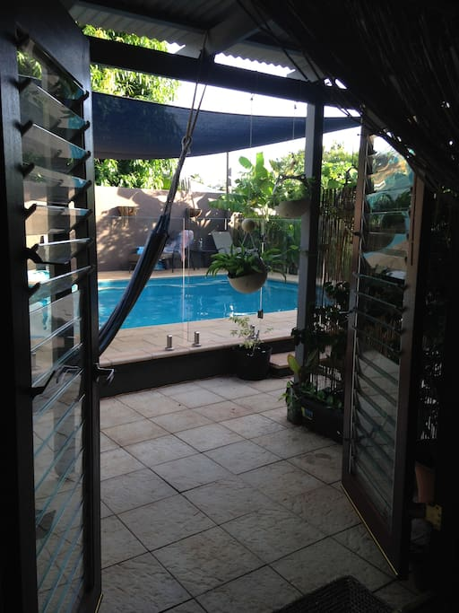 French doors opening out onto pool