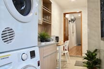 The common area also includes a washer and dryer.
