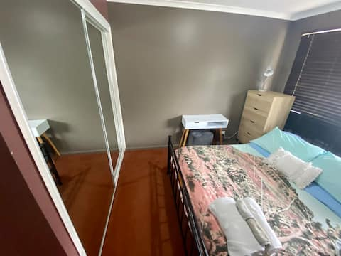 Tidy bedroom in cozy townhouse