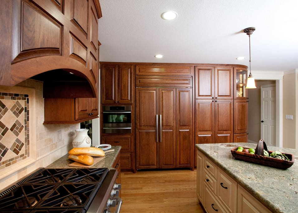 Large refrigerator and plenty of cupboard space.