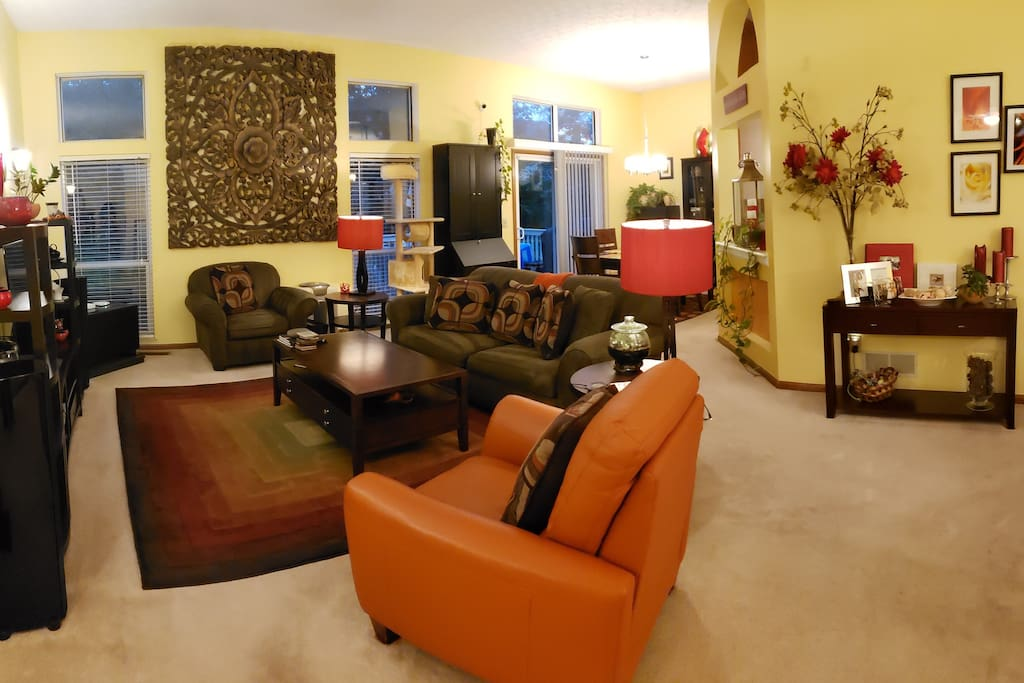 Relaxed living room with TV. There is also another living area with TV in the lower level. Wifi, cable, and Chromecast is available throughout the home for guest use.