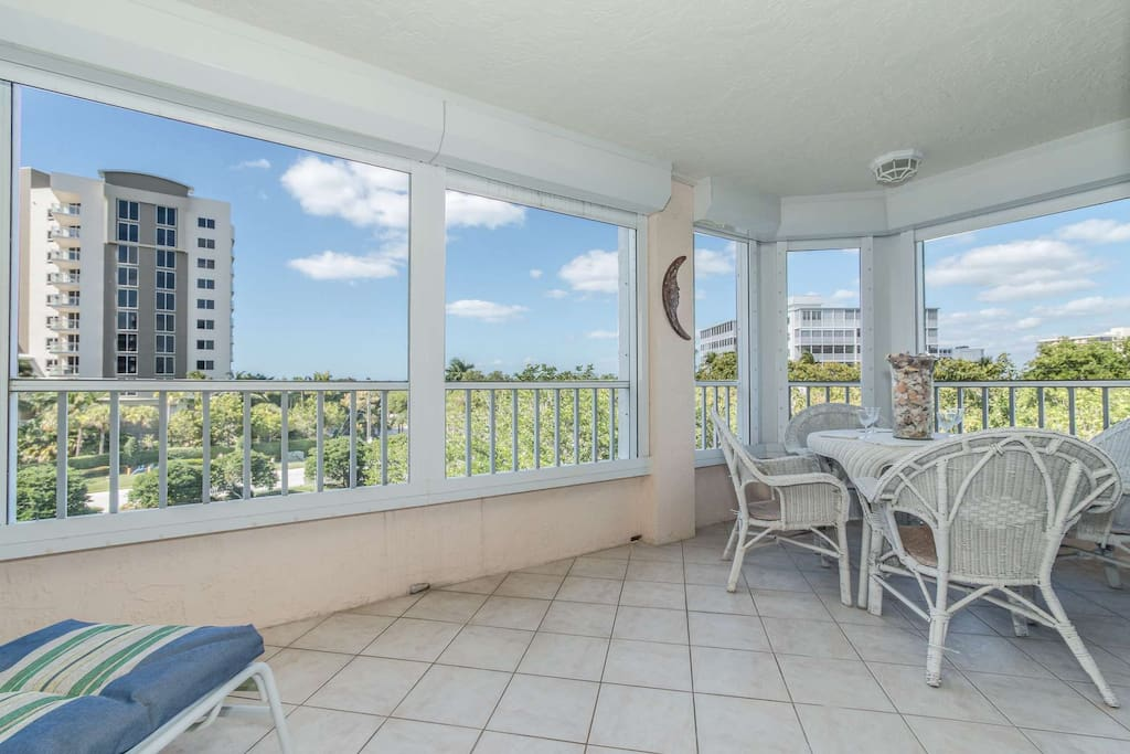 Relax on your spacious screened lanai in this gated community with secure bldg. & elevator access to condo w/covered pkg. space under bldg.