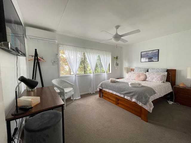 """Bedroom includes - Queen bed, linen and towels, reverse cycle air conditioner, clothes rack with hangers, desk, 2 bedside tables, 2 drawers under the bed for storage, 42"""" Smart TV with access to Netflix, Stan, ABC Iview, You Tube and SBS on Demand."""