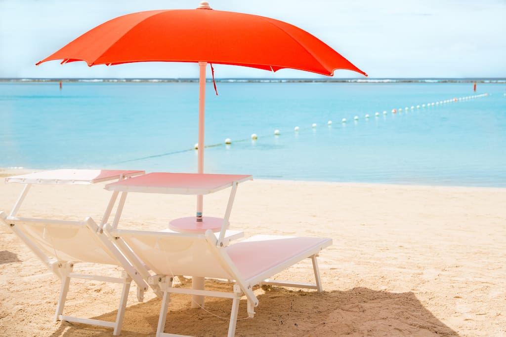 Lounge beach chairs and sunshades included