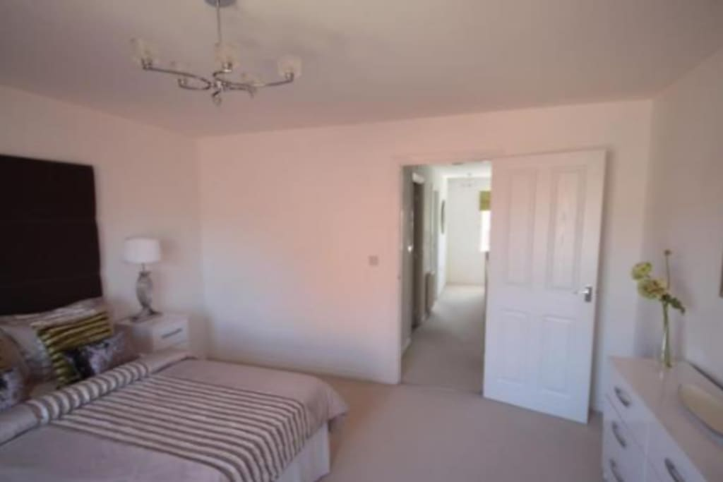 Bedroom 2. Beautiful room well furnished and private access to ajoining large bathroom including bath and toilet and washbasin.Large slide door wardrobe.