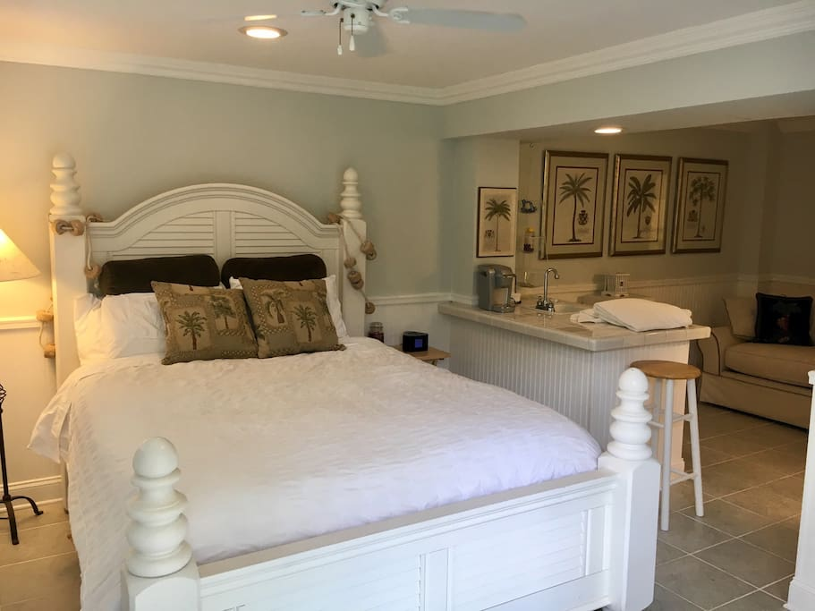 Comfy and cozy Four Post Shutter Style Queen Bed