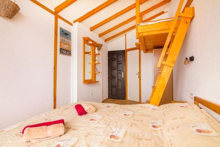 Triple room, one queen bed and one mezzanine bed