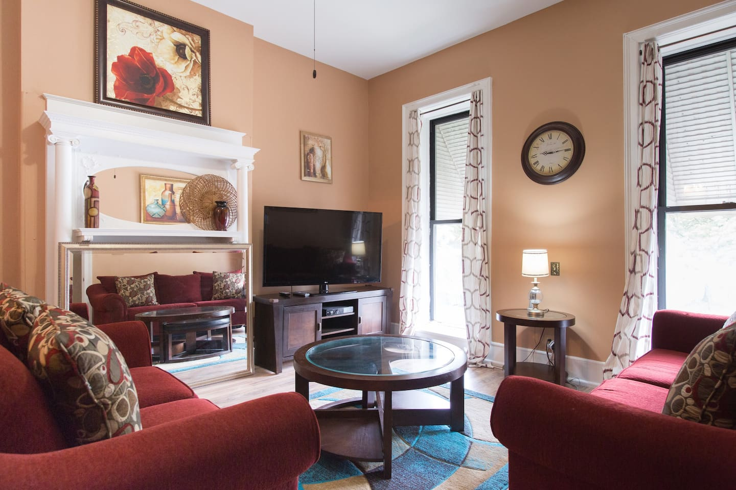 """Comfy sofa, loveseat and 55"""" HDTV will make you feel at home. Relax after enjoying everything that the great city of Chicago has to offer."""