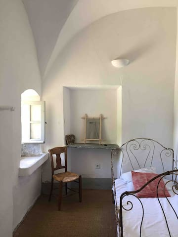 Entrance foyer with extra bed and space for day reading or resting, or luggage storage in Soeur Simone's apartment.