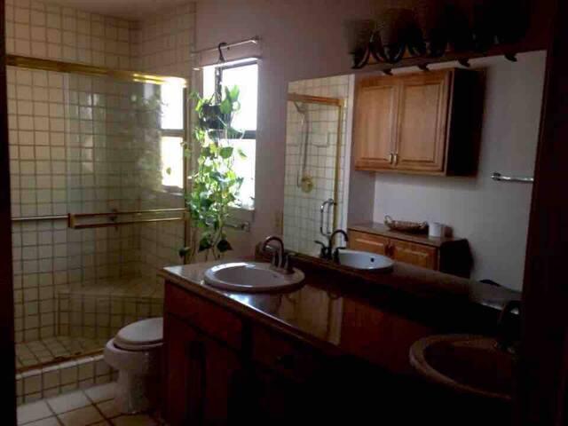 tiled shower, double sinks