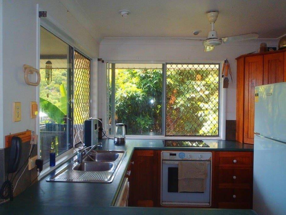 Kitchen with dishwasher, hob, oven, toaster, etc