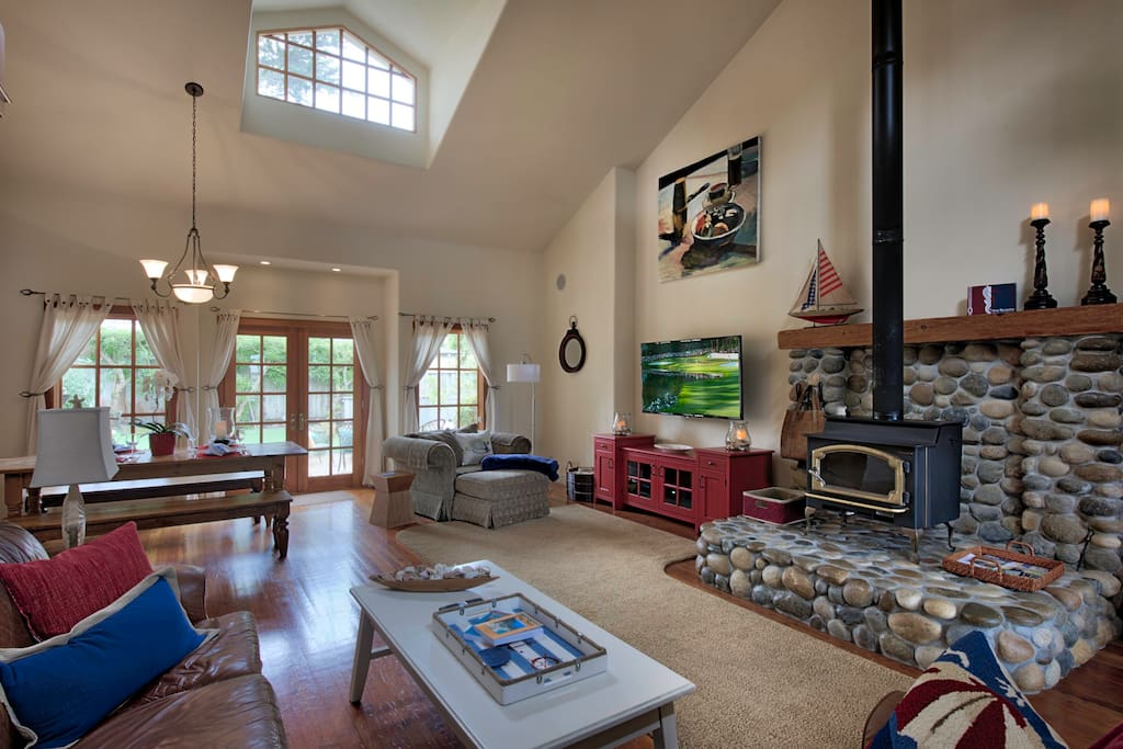 A vaulted open-beam ceiling lends an expansive feel to the Great Room.