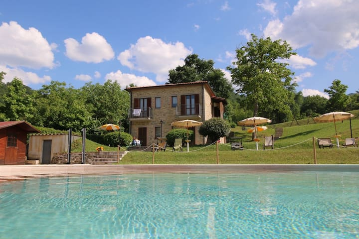 Property with swimming pool, spacious garden, private terrace and views