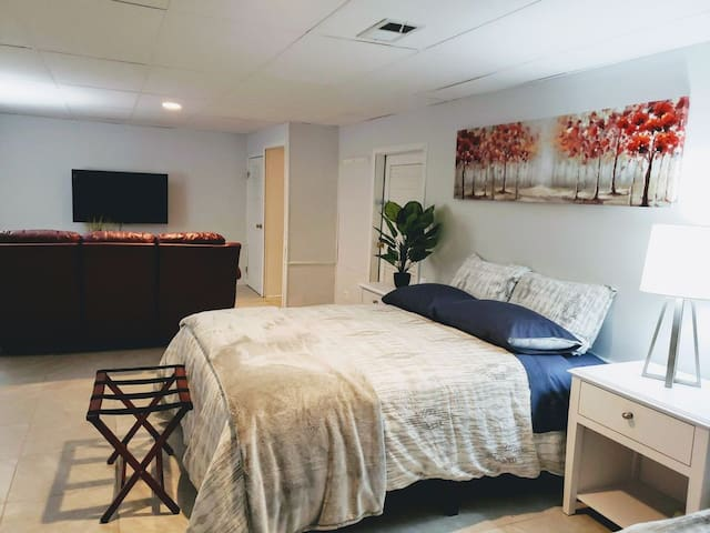 The basement includes an additional 4K smart TV sofa and bed.