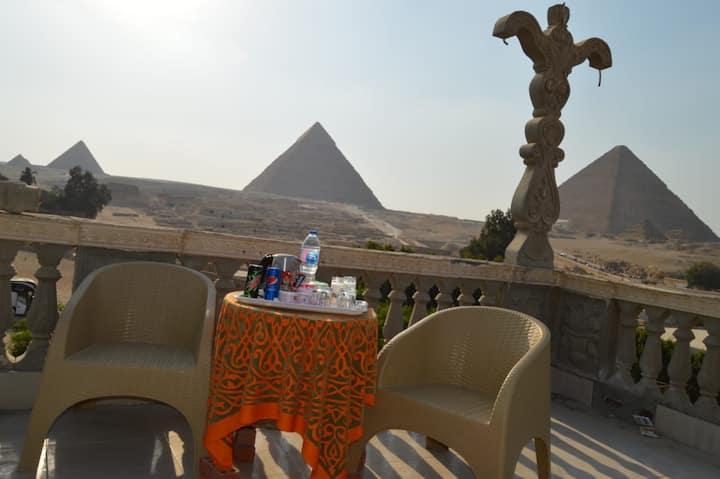 Sphinx palace pyramids view 2