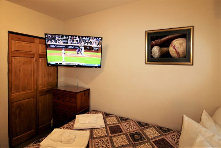 """Bedroom #1 with 43"""" (or larger) flat screen smart Roku TV to watch all your favorite teams or shows from the comfort of your air-conditioned bedroom"""