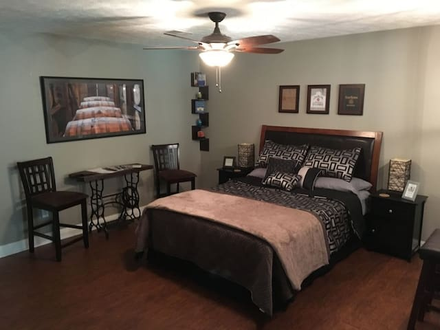 Bedroom with queen size bed and memory foam mattress. Extra pillows and blankets are provided.