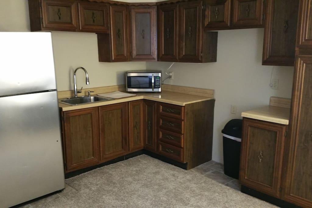Full size fridge, New Microwave, Dishes furnished.