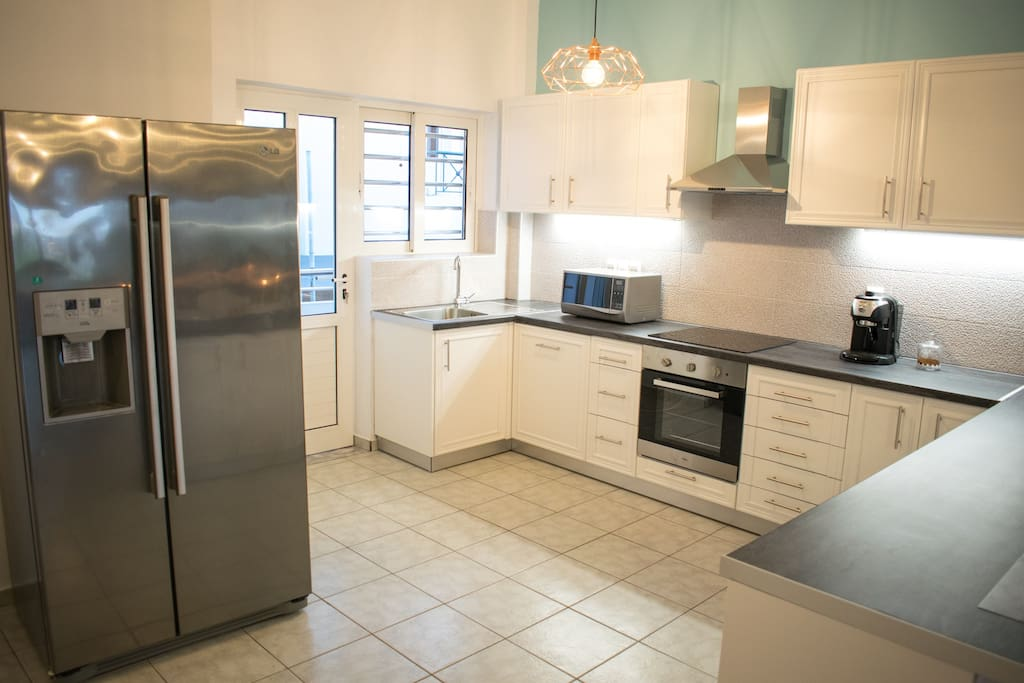 Kitchen - Equipped with ceramic hob, oven, large fridge, microwaves, dish washing machine, espresso machine