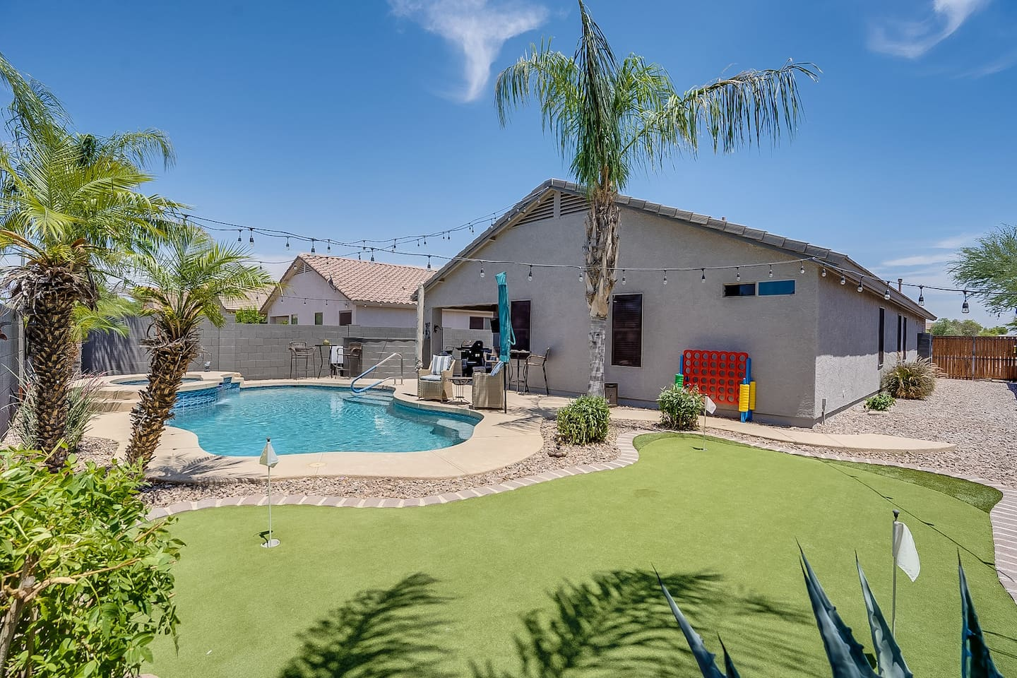 Large Pool and Jacuzzi. 3 hole Putting green. Outdoor games and Lounge chairs