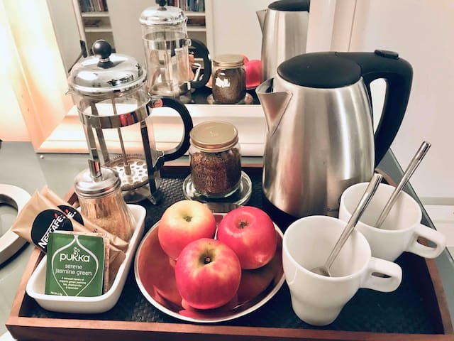 Breakfast tray with complimentary tea and Nescafe options for breakfast A bottle of complimentary water will also be ready for you to make your morning tea or coffee.