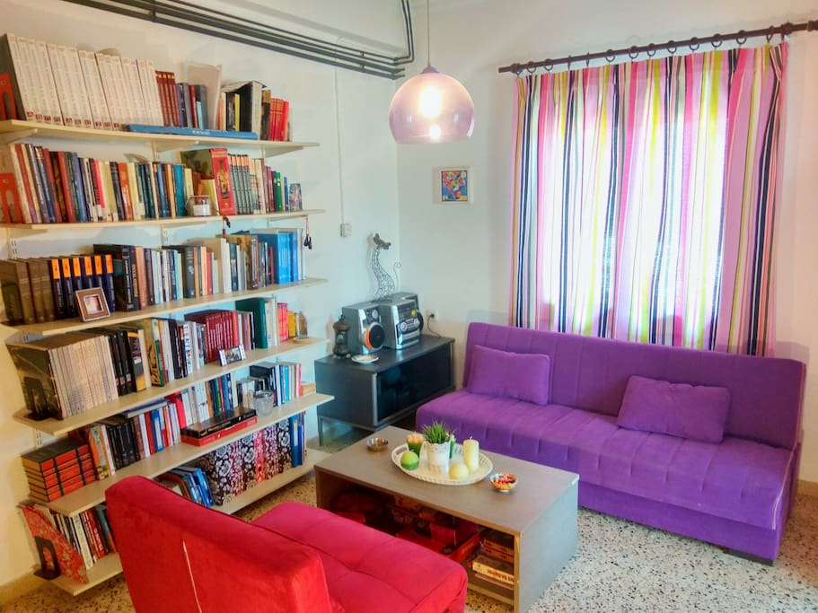 My library, which I am very proud of. You can also see the sofa and the sofa chair, both capable to transform to extra beds.
