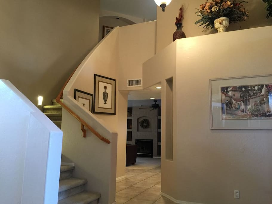 Entry way to home, family room with Fireplace