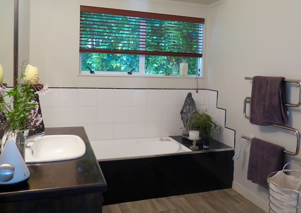Main bathroom with bath and separate shower.
