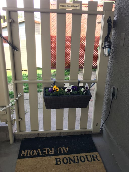 Welcome! This is the entrance gate in the carport. Key lock box available to make check in simple.