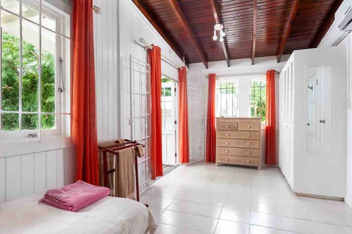 Spacious bedroom with access to the back deck and en suite facilities