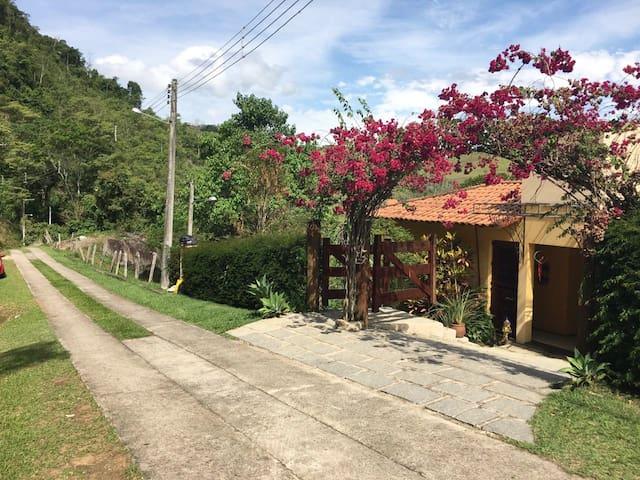 Apartamento em casa de campo