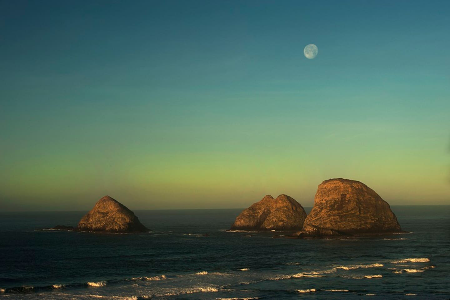 Full moon over  Oceanside's Three Arch Capes from the unique tree deck of Knotty Pine~