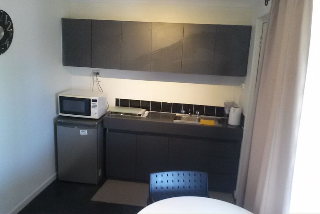 own kitchenette with fridge, microwave.