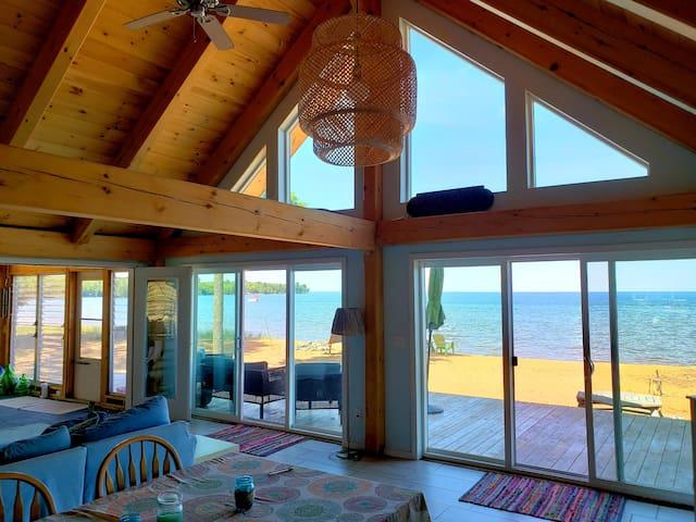 Beach house on sandy bay.