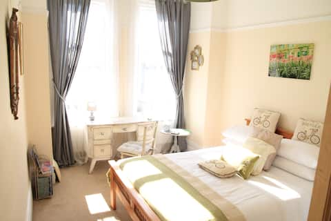 Lovely bright double bedroom in a large apartment.