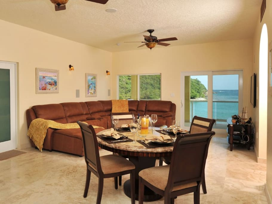 Spacious living and dining area, Home Theater System, sweeping ocean view balcony with outdoor dining Two Bedroom Two Bathroom Spa