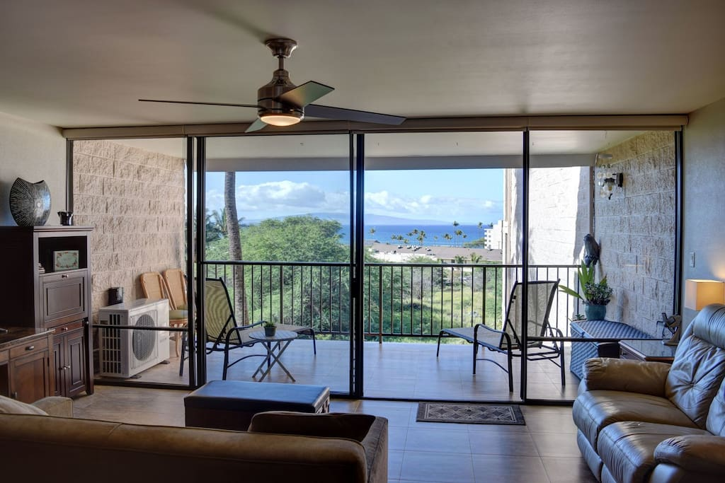 Floor to ceiling lanai door windows allow for expansive ocean view and plenty of natural light