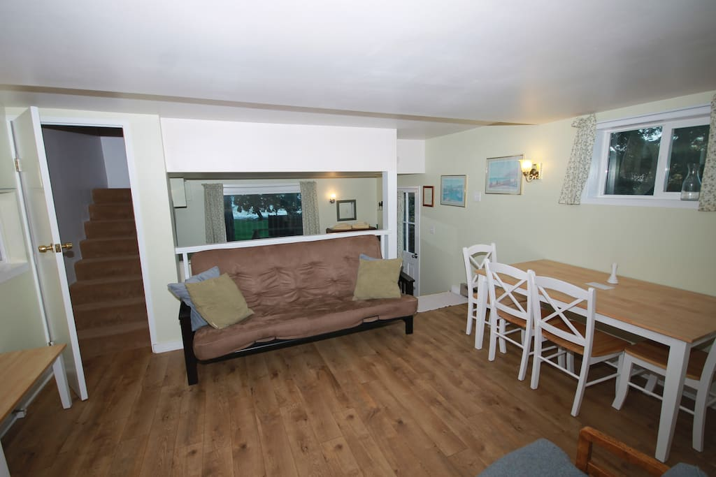 Living/dining area with stairs to upper bedroom