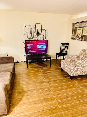 Living Room with 50 inch Smart TV and comfortable sofa