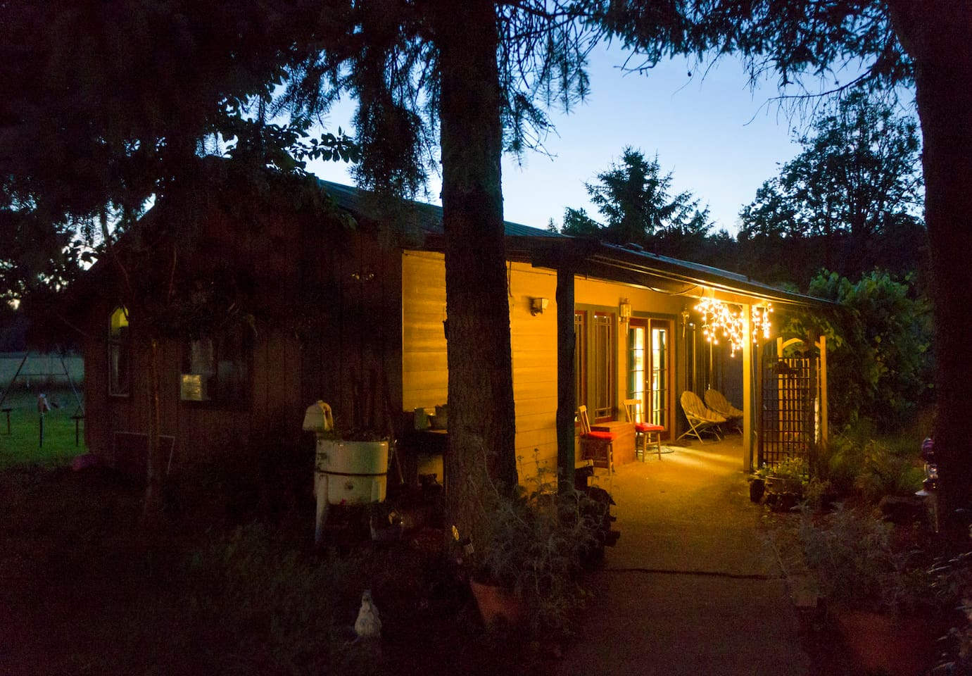 The warm glow of the Calapooia Farm House as the crickets chirp and the frogs sing their lullaby.