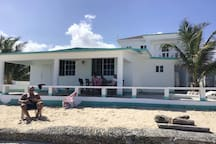 Enjoy your vacation on the beach!  With the beach and the sea just steps away from the house you can take a dip, sun bathe or just relax on the patio.