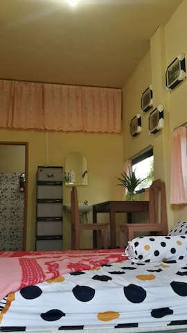 1 bedroom and private bathroom surround by garden